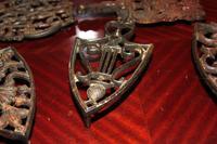 5 Antique Iron Rests