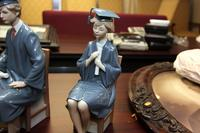 Lladro Figurines of a Girl and Boy Graduate