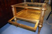 Gold Colored Table with Glass Top